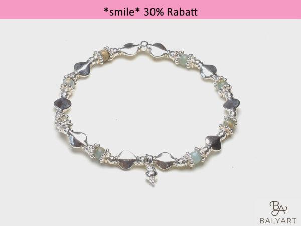 Arm_Opal_Herz_smile